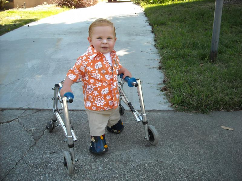 Joshua learning to walk with a walker
