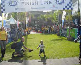 Josh crossing the finish line